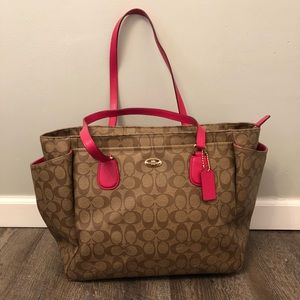 Coach diaper bag with pink straps